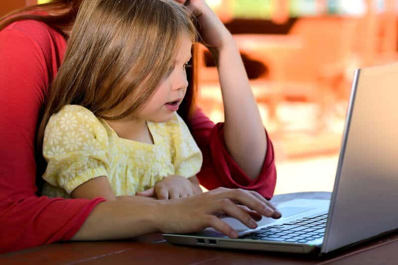 Young girl learning how to code
