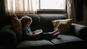 Child reading indoors