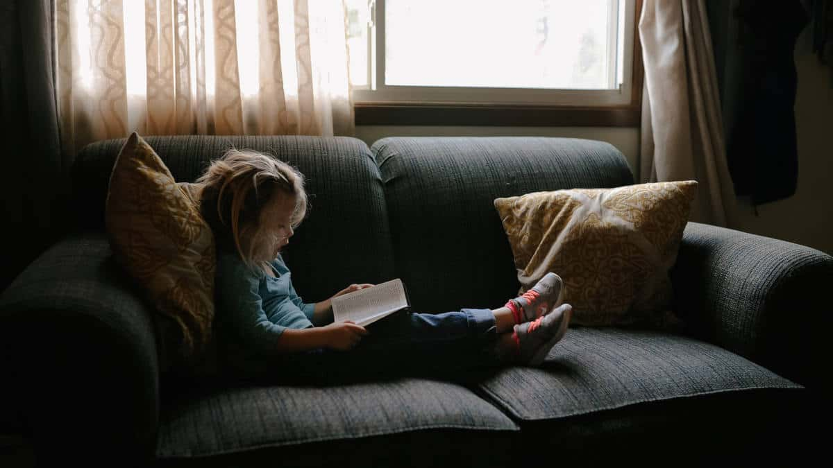 Child reading indoors