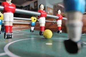 Foosball table foosmen lining up shot