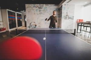Opponent playing a spin shot in ping pong