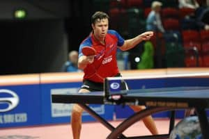 Table tennis player using the Shakehand grip
